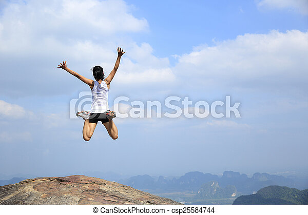 freedom young asian woman jumping - csp25584744