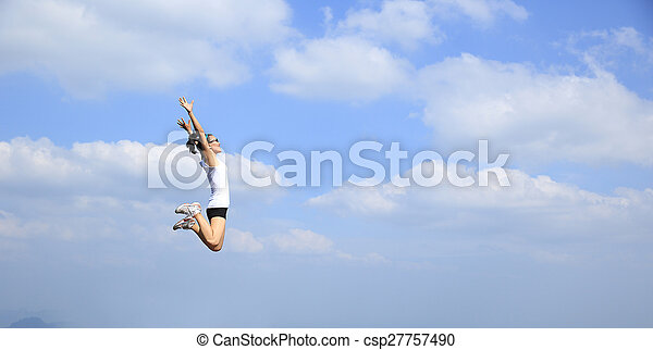 freedom young asian woman jumping - csp27757490