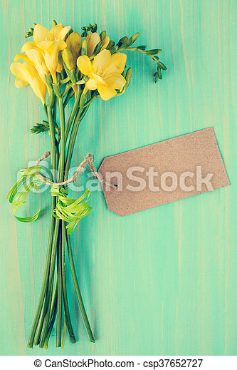 Freesia flowers with blank tag - csp37652727