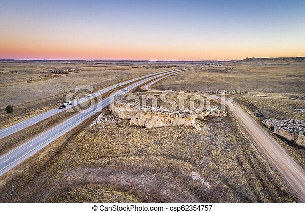 freeway across rolling prairie - csp62354757