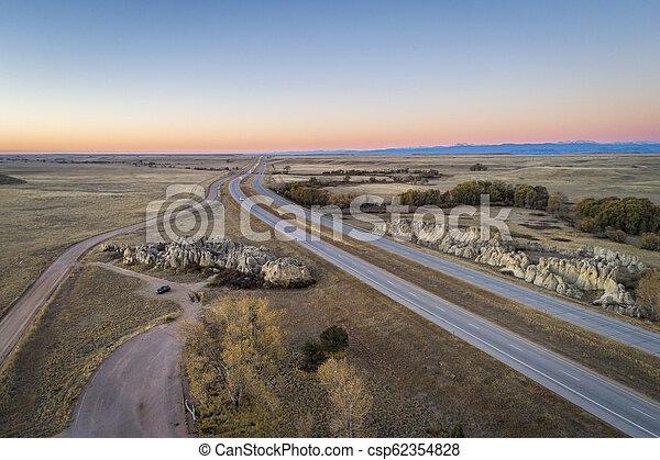 freeway across rolling prairie - csp62354828
