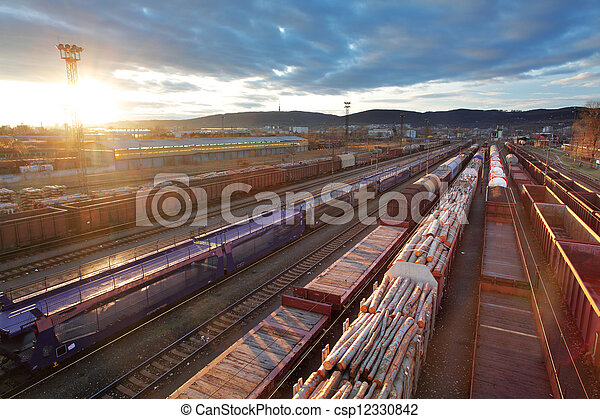 Freight Station with trains at sunset - csp12330842