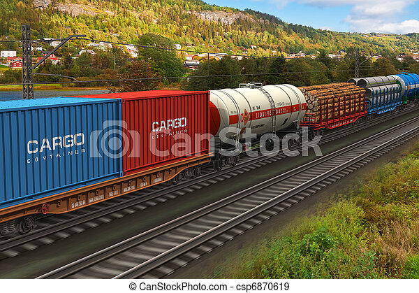 Freight train passing by mountain range - csp6870619