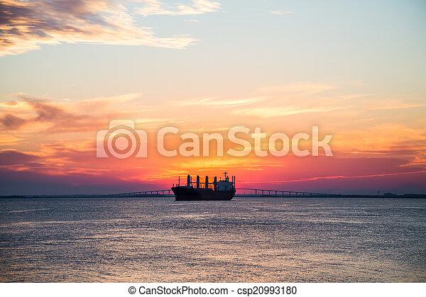 Freighter on Sunset Horizon - csp20993180