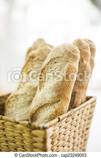 french baguette in basket - csp23249003