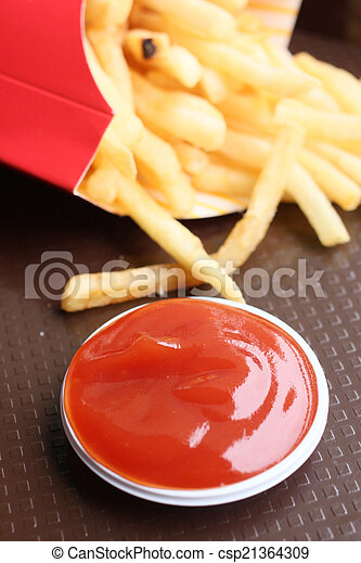 French fries with ketchup - csp21364309
