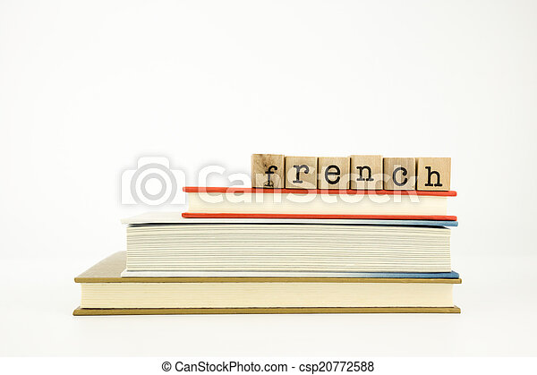 french language word on wood stamps and books - csp20772588