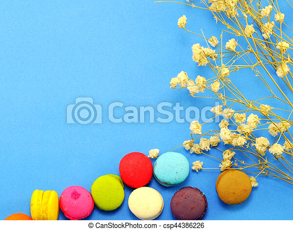 french macaroons with dried flower and copy space background