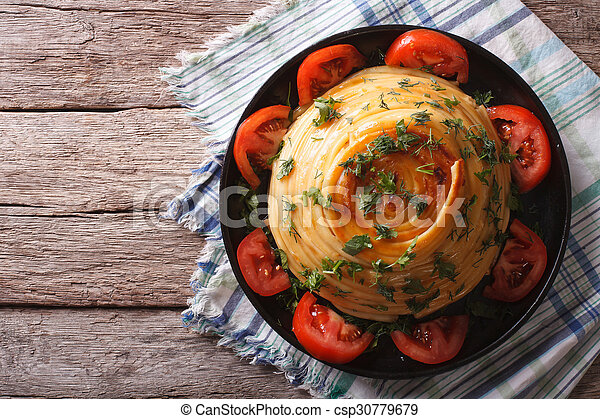French timbale of pasta with cheese and vegetables. horizontal top view - csp30779679