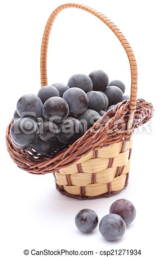 Fresh and natural grapes in wicker basket on white background - csp21271934
