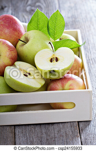 Fresh apples in a wooden box - csp24155933