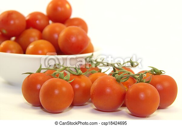 Fresh baby tomatoes on a branch - csp18424695