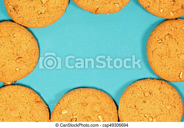 Fresh baked peanut cookies on rustic background - csp49306694