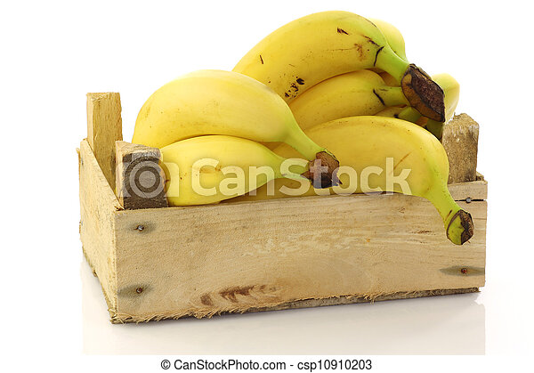 fresh bananas in a wooden crate - csp10910203