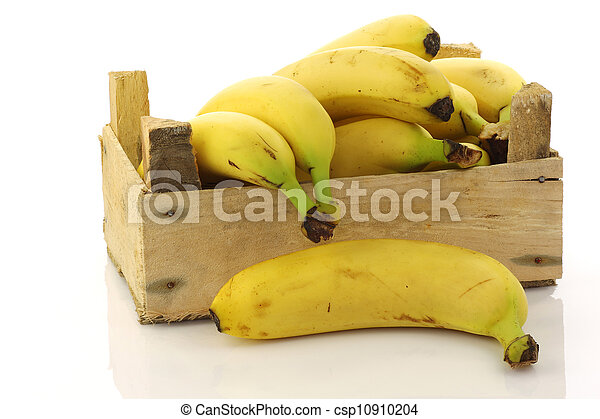 fresh bananas in a wooden crate - csp10910204