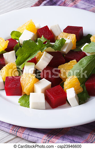Fresh beet salad with oranges, cheese and arugula, vertical  - csp23946600