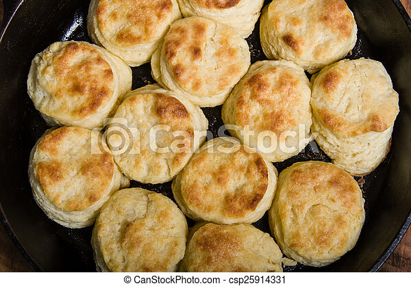 Fresh biscuits baked in a cast iron skillet - csp25914331