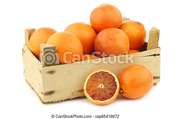 fresh blood oranges in a wooden crate - csp65416672