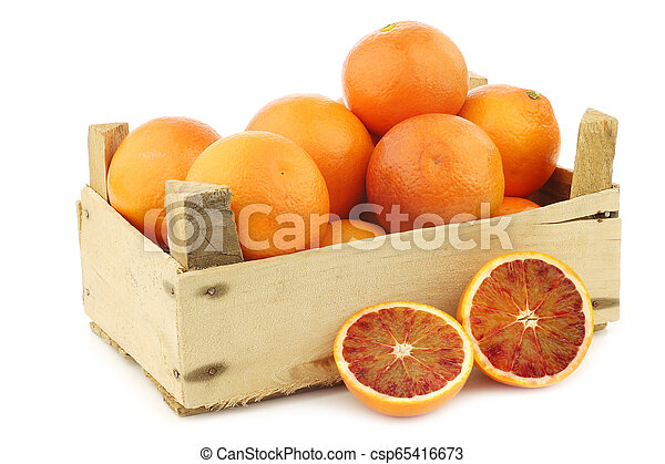 fresh blood oranges in a wooden crate - csp65416673