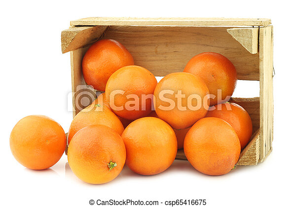 fresh blood oranges in a wooden crate - csp65416675