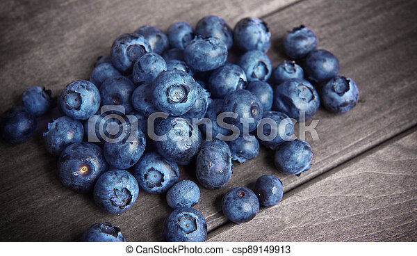 fresh blueberries on wooden table - csp89149913