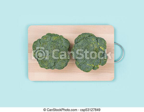 Fresh broccoli on a chopping board - csp53127849