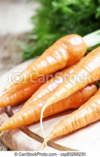 Fresh carrots, shallow depth of field, selective focus - csp83268230