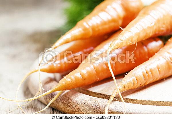 Fresh carrots, shallow depth of field, selective focus - csp83301130