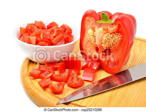 Fresh chopped bell pepper with a knife blade on cutting board - csp25210288