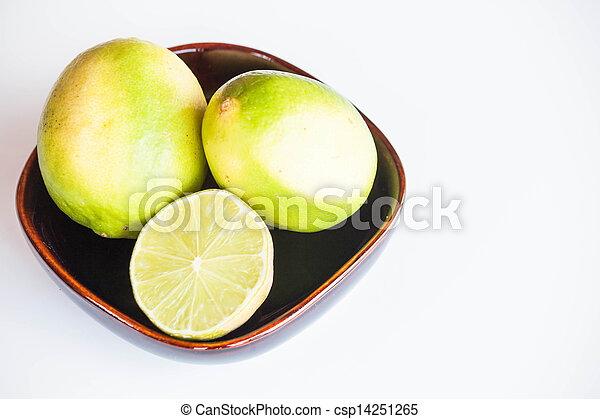 Fresh citrus limes whole and slice in bowl on white background - csp14251265