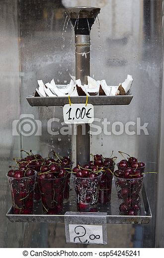 Fresh coconut and cherries sale in a stall on the streets of Venice - csp54245241