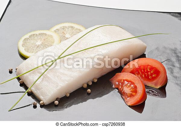 fresh cod on black dish - csp7260938