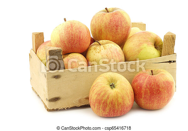 fresh cooking apples in a wooden crate - csp65416718