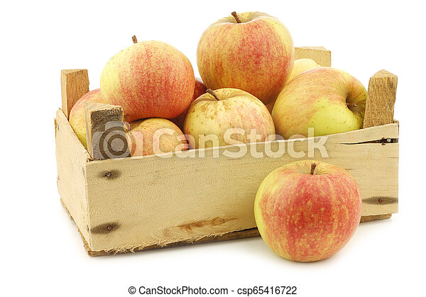 fresh cooking apples in a wooden crate - csp65416722