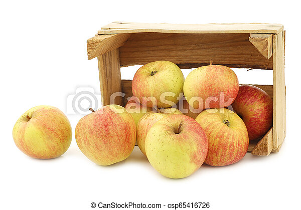 fresh cooking apples in a wooden crate - csp65416726