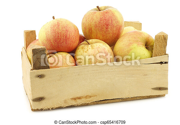 fresh cooking apples in a wooden crate - csp65416709