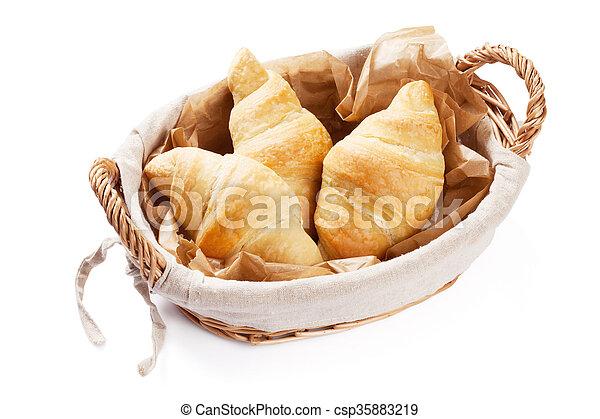 Fresh croissants basket - csp35883219