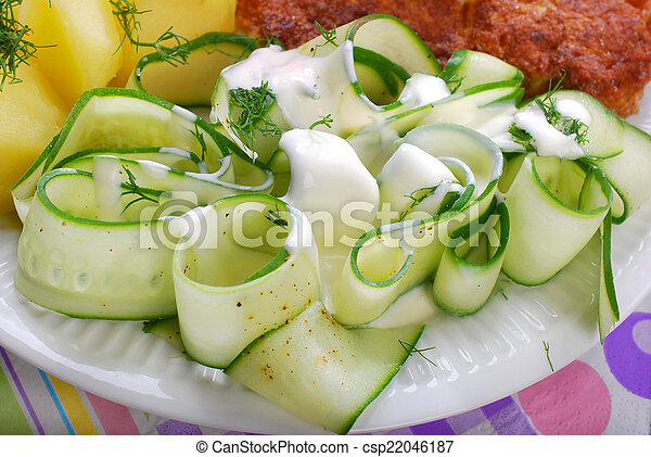 fresh cucumber salad with sour cream and dill - csp22046187