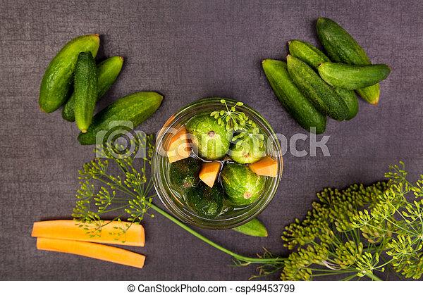 Fresh cucumbers in jar. Preserved vegetable. - csp49453799