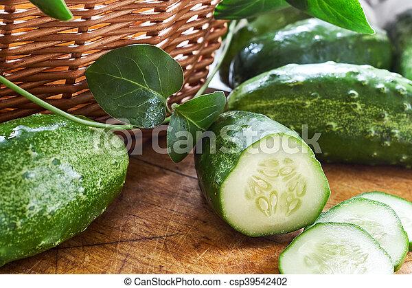 Fresh cucumbers on cutting board - csp39542402