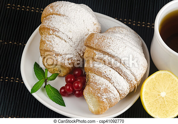 fresh cup of hot black coffee with croissants and lemon - csp41092770