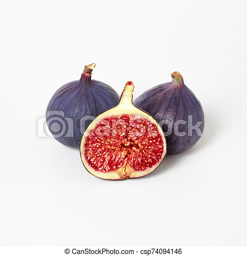Fresh figs isolated on white background. Food Photo. Purple Fig with red seeds close up. Side view. - csp74094146