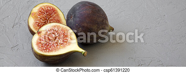 Fresh figs on concrete background, side view. Close-up. - csp61391220
