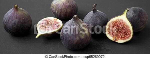 Fresh figs on dark black background, side view. Close-up. - csp65269072