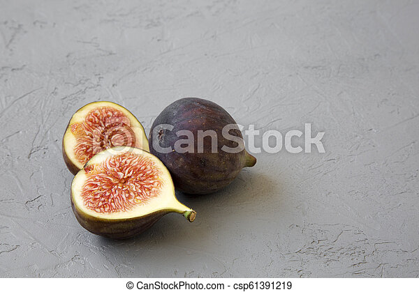 Fresh figs on grey background, side view. Close-up. Copy space. - csp61391219