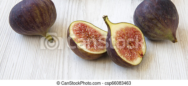 Fresh figs on white wooden background, side view. Close-up. - csp66083463