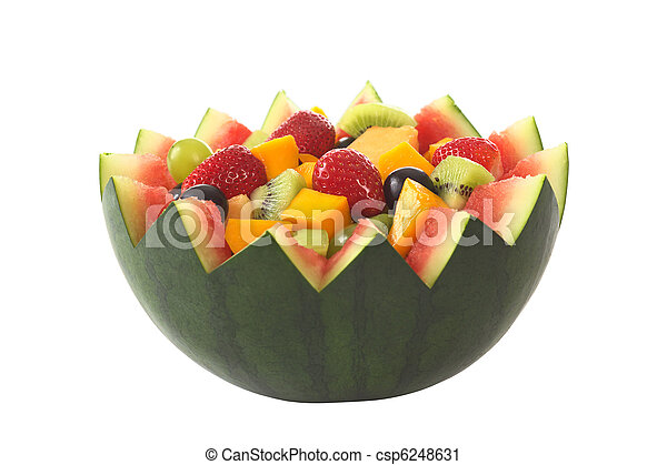 Fresh fruit salad of mango, strawberry, kiwi and grapes in a bowl from watermelon isolated on white (Selective Focus, Focus in the middle of the fruit salad)  - csp6248631