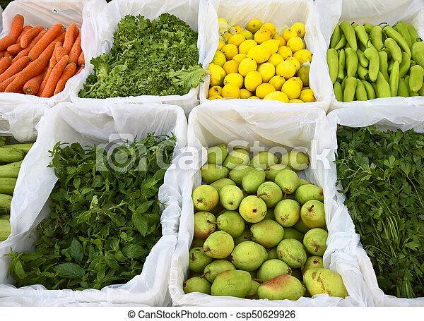 Fresh fruits and vegetable at a market. - csp50629926