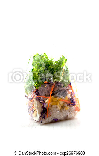 Fresh fruits and vegetable salad in packing  on white - csp26976983
