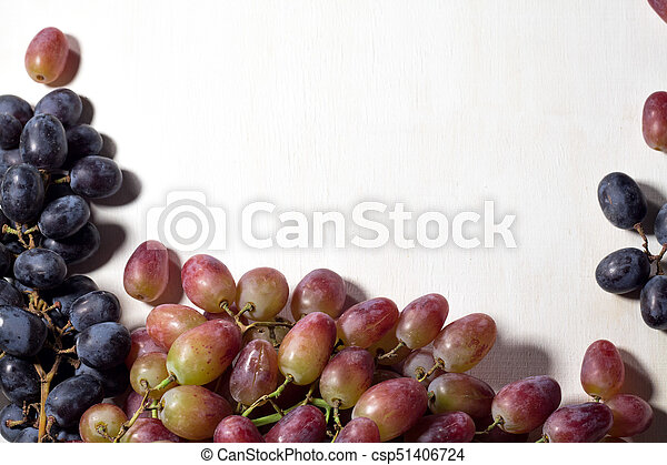 Fresh fruits grapes, pear and apple on wooden boards frame background. - csp51406724